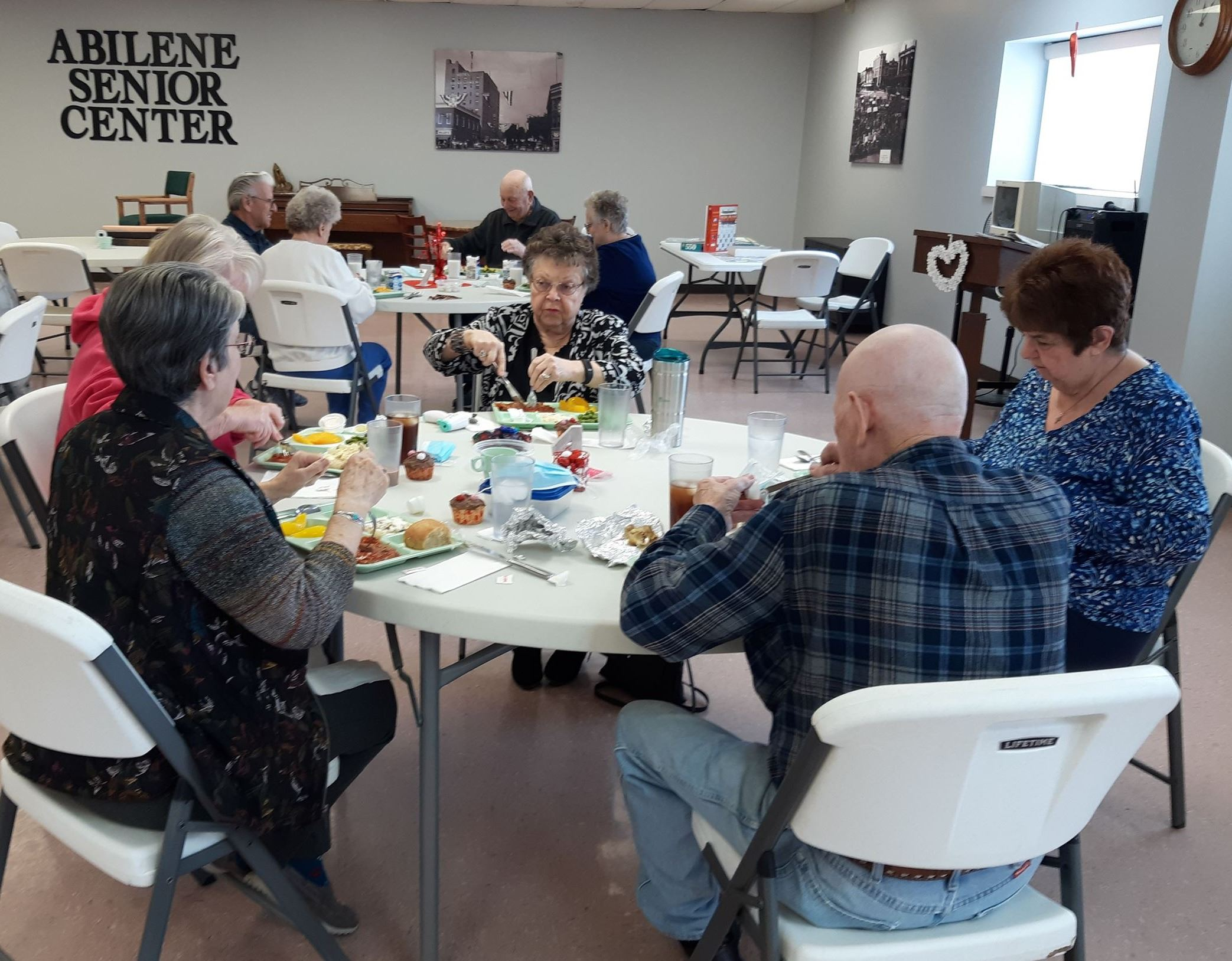 People visiting over lunch at the Abilene Senior Center